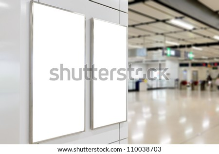 Two big vertical / portrait orientation blank billboard on modern white wall with concourse background - stock photo