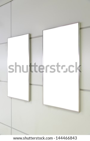 Two big vertical / portrait orientation blank billboard on white wall - stock photo