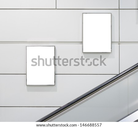 Two big vertical / portrait orientation blank billboard with escalator background - stock photo