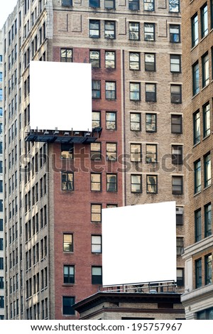 Two big white blank billboards on the brick building. - stock photo