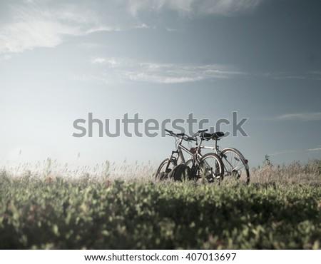 Two bike on a blue sky - stock photo