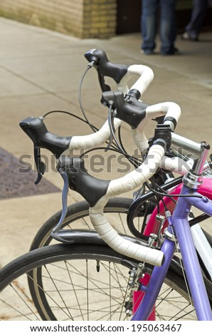 Two bikes are parked in the downtown area of Portland Oregon a bicycle friendly city - stock photo
