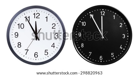 Two black and white office round clock isolated on white background. Time concept - stock photo