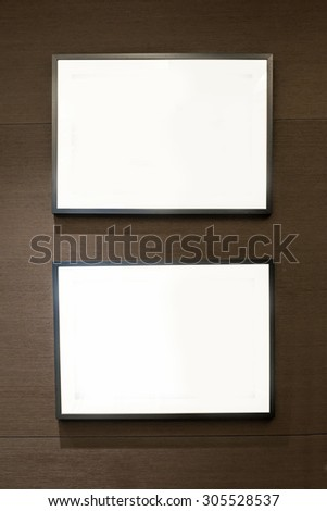 two black frames on dark wooden wall - stock photo