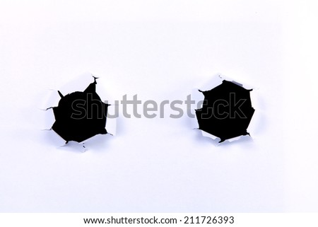 Two Black hole in white paper for advertisement. - stock photo