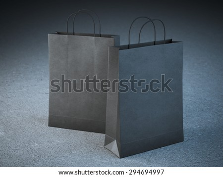 Two black paper bags with handles  - stock photo