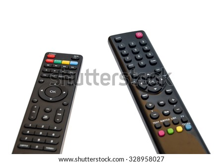 Two black TV remote control on white background - stock photo