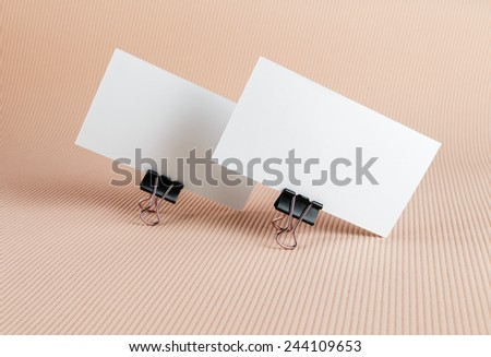 Two blank business card on color background. - stock photo