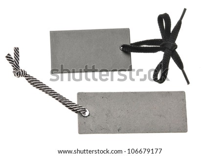 two blank cardboard paper labels or tag isolated on the white background - stock photo