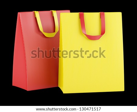 two blank red and yellow shopping bags isolated on black background - stock photo