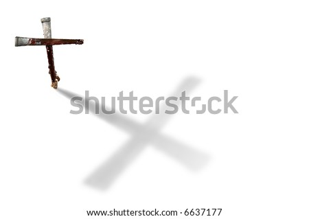 Two bloody nails in the form of a Christian cross casting a large shadow. - stock photo