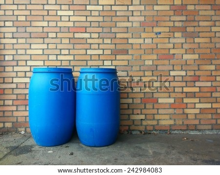 two blue chemicals barrels background - stock photo