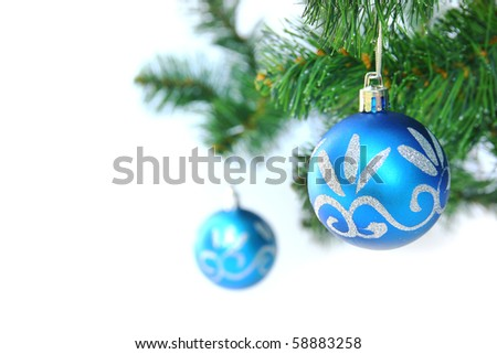 Two blue christmas ball in a christmas tree - stock photo