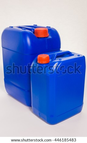 Two blue plastic canisters, containers; isolated on white background  - stock photo