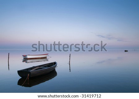 Two boat on calm evening - stock photo