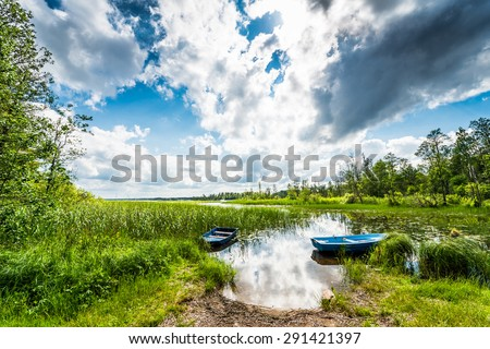 Two boats on the lake in the woods - stock photo