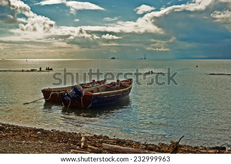 Two boats on the ocean. - stock photo