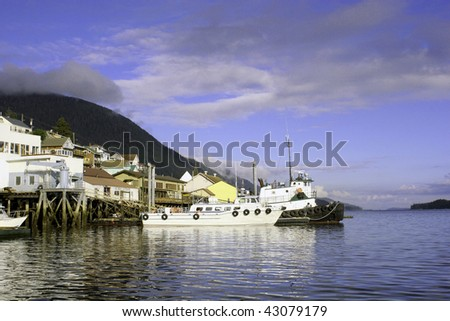 Two boats parked in the harbor of a small town in Alaska. - stock photo