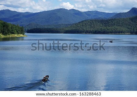 two boats travel in the reservoir of Mae Ngat Somboonchol Dam  Chiang Mai, Thailand - stock photo