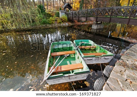 Two boats with oars in the water - stock photo