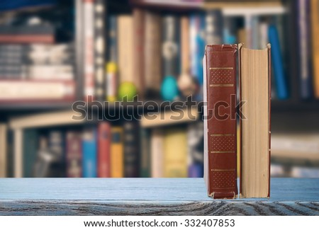 Two books on a table - stock photo
