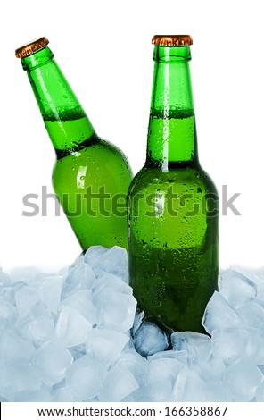 Two bottles of beer on ice isolated - stock photo