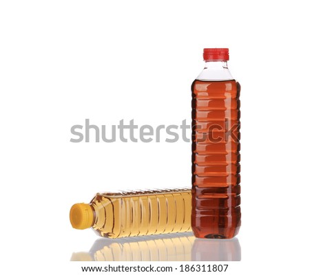Two bottles of vinegar. Isolated on a white background. - stock photo