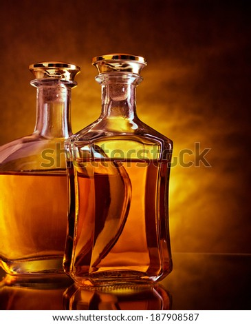 Two bottles of whiskey and brandy - stock photo
