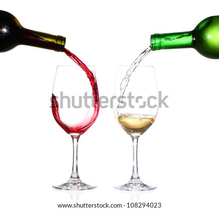 Two bottles of wine and glasses - stock photo