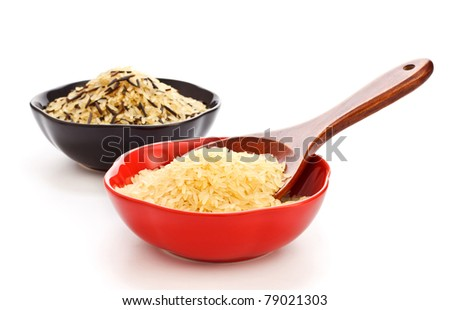 two bowls with rice and wooden spoon - stock photo