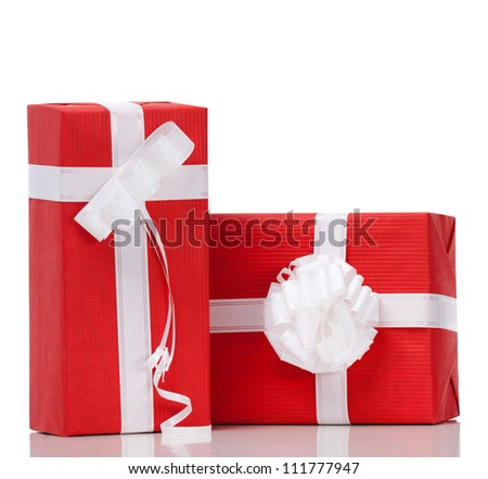 Two boxes with presents wrapped in red paper, isolated on white - stock photo