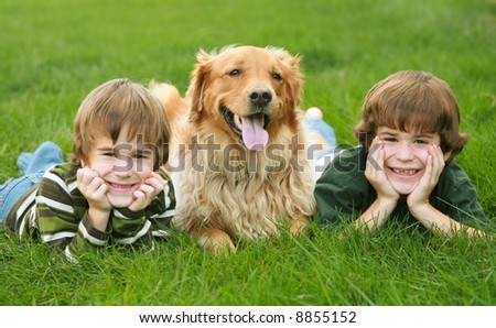 Two Boys and a Dog - stock photo