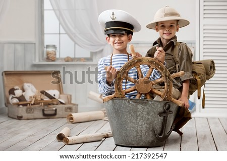 Two boys, captain and traveler , playing in the bathroom in my room - stock photo