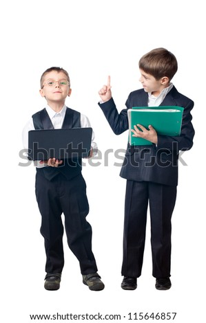 Two boys dressed up in suits holding laptop and folder, isolated on white background - stock photo