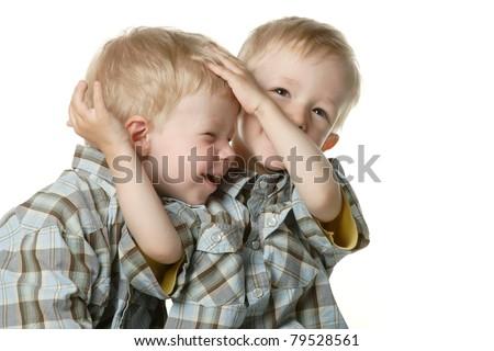 Two boys in a fun children's struggle - stock photo