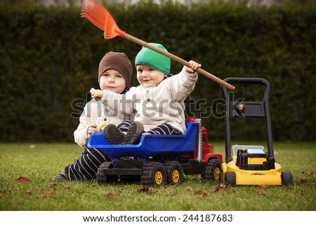 Two boys in outdoor game - stock photo