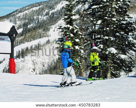 Two boys on the slopes of Steamboat Springs, Colorado - stock photo