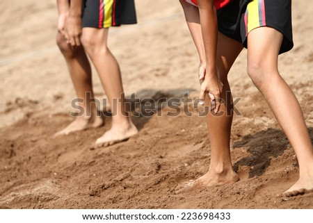 two boys playing beach volleyball - stock photo