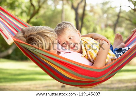 Two Boys Relaxing In Hammock - stock photo