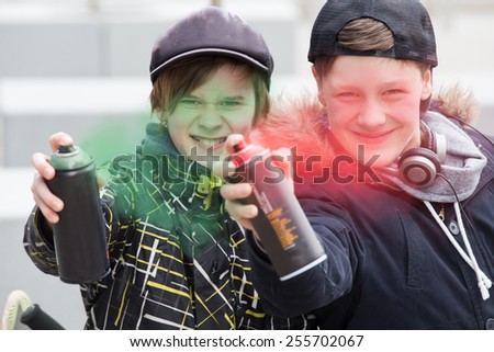 Two boys spray painting - stock photo