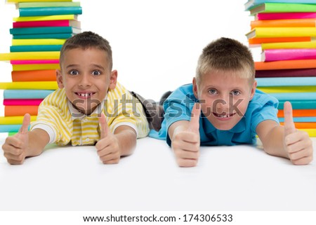 two boys surrounded with books  - stock photo