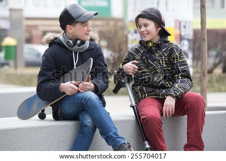 Two boys talking - stock photo