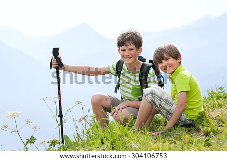 two boys - tourist in summer the Alps - stock photo
