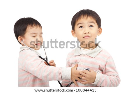 two boys using stethoscope Check the heartbeat - stock photo