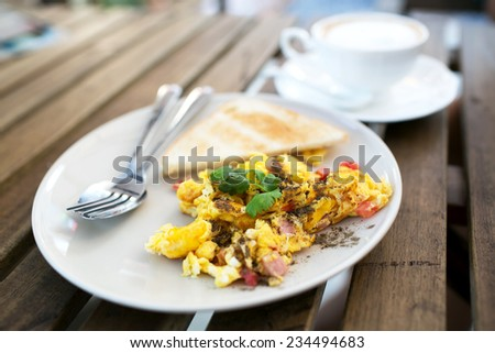 Two breads and Delicious Egg Omelette with Greens and Sauce on wood - stock photo