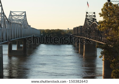 Two bridges over water - stock photo