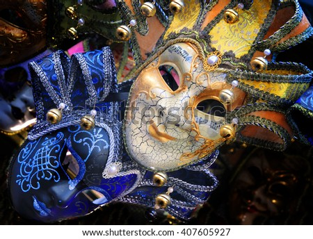 two bright carnival venetian mask, blue and gold - stock photo