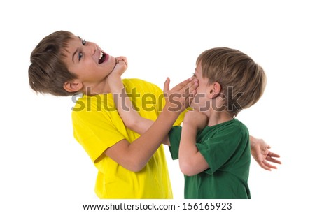 two brother fighting isolated on the white background - stock photo