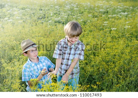 Two brother huging each other outdoor, - stock photo
