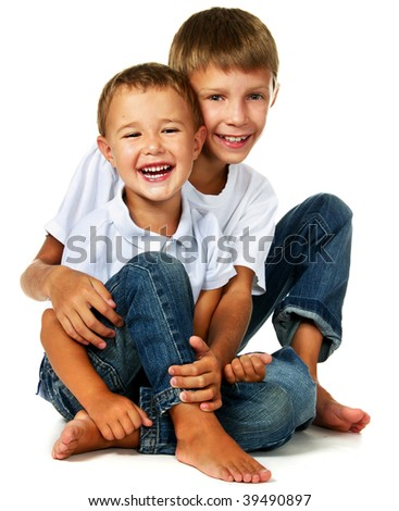 two brother sitting on floor - stock photo